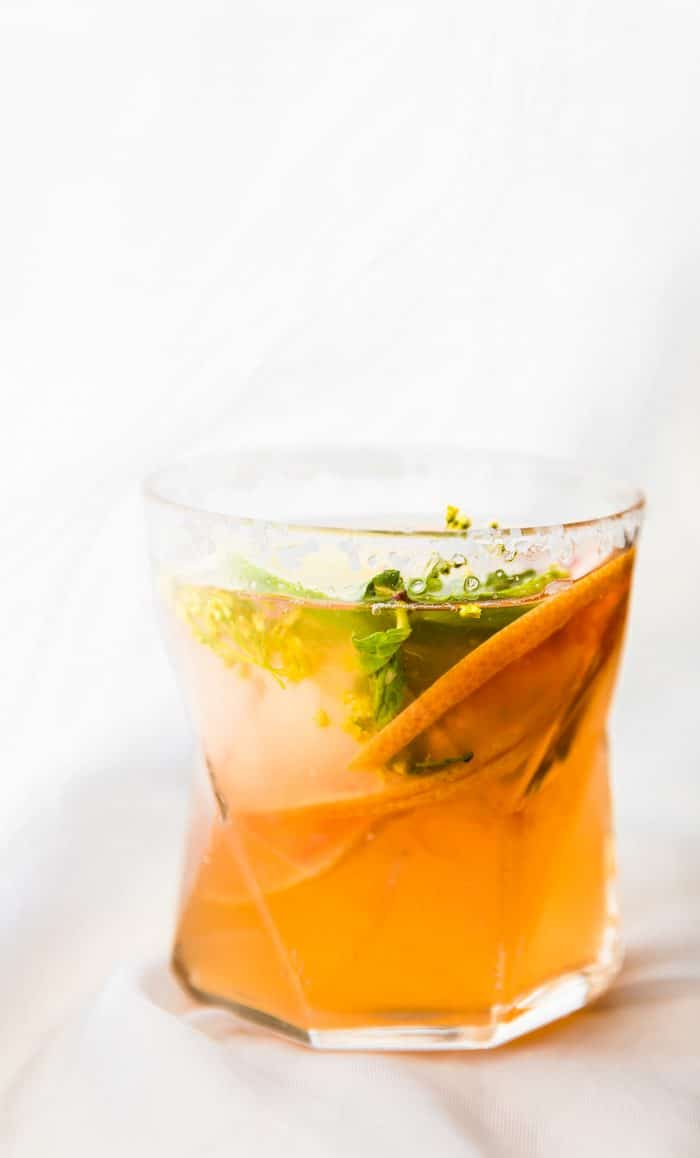 cocktail with herbs and lemon