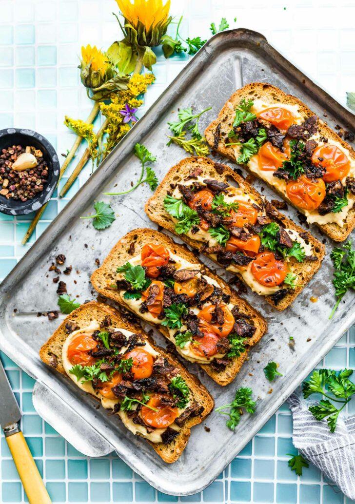 vegan breakfast toast with tomato and hummus