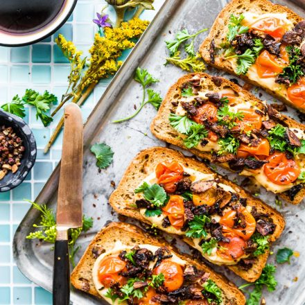 Mushroom Bacon Breakfast Toast is a plant-based, gluten-free breakfast recipe that will transform the way you think of toast! A vegan bacon substitute, made from smoky mushrooms, sits on a bed of hummus with tomato and fresh herbs. This healthy hummus toast is full of protein, fiber, and flavor.  #breakfastrecipes #hummustoast #veganbacon