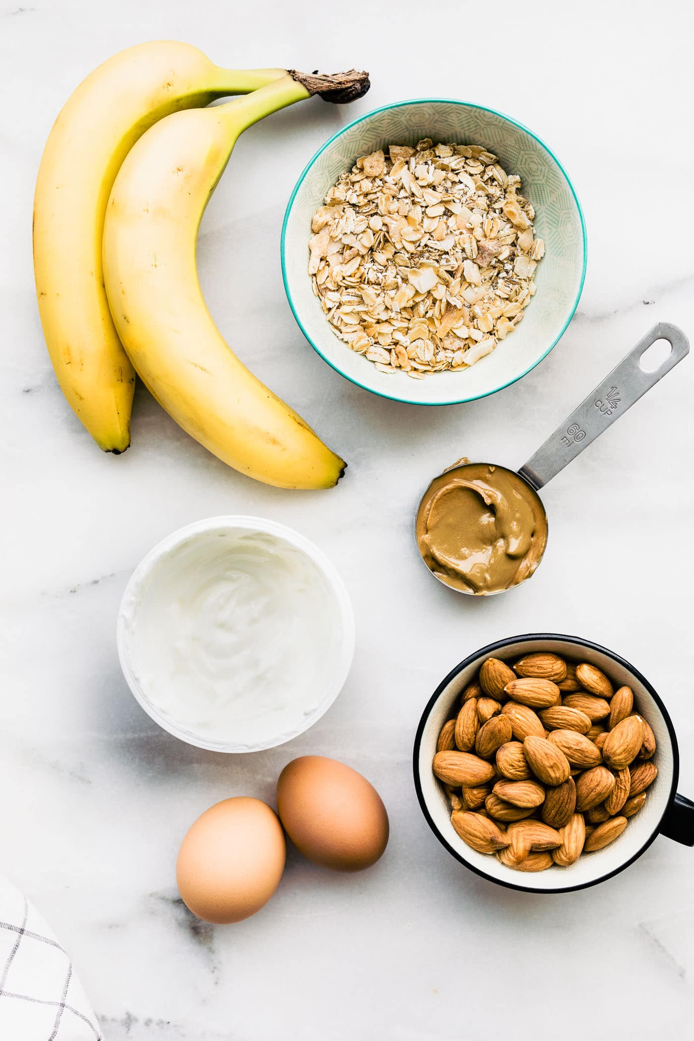 ingredients for flourless banana bread with oats and almonds and greek yogurt