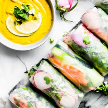 platter of vegan spring rolls with curry dipping sauce