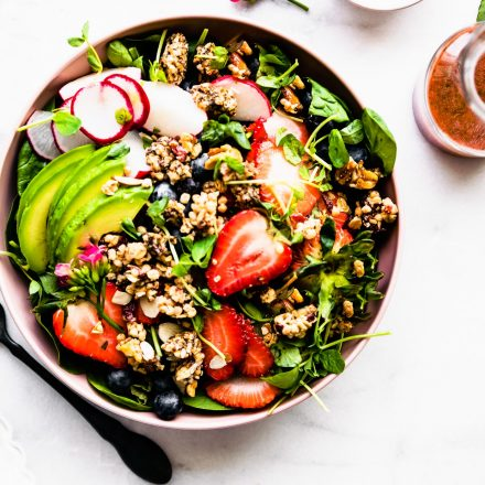 overhead image: strawberry spinach salad with granola croutons