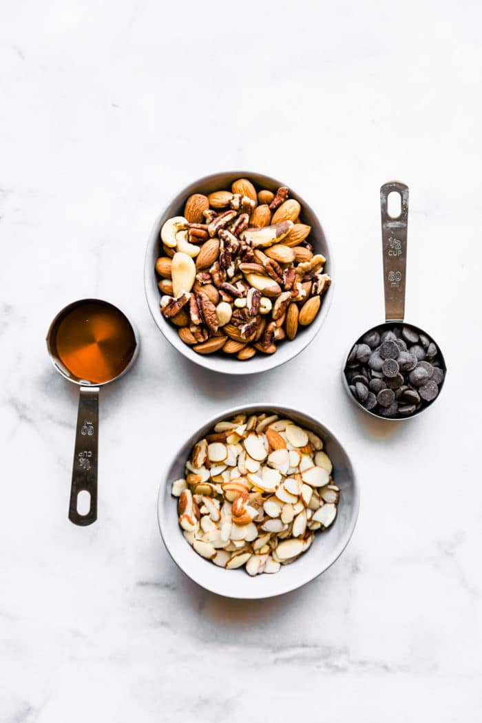 ingredients in measuring cups for a grain free granola recipe