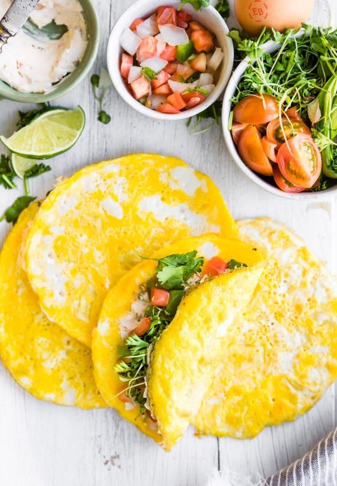 paleo breakfast egg wraps stuffed with fresh vegetables