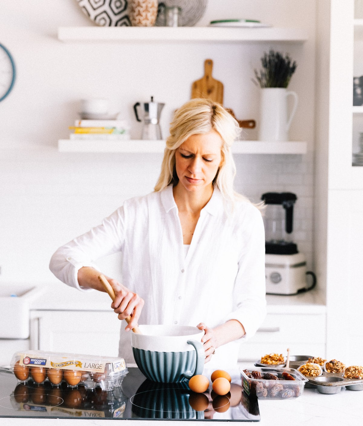 woman with blonde hair making muffins