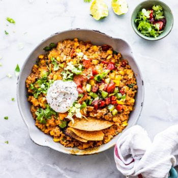 mexican quinoa skillet dinner topped with sour cream