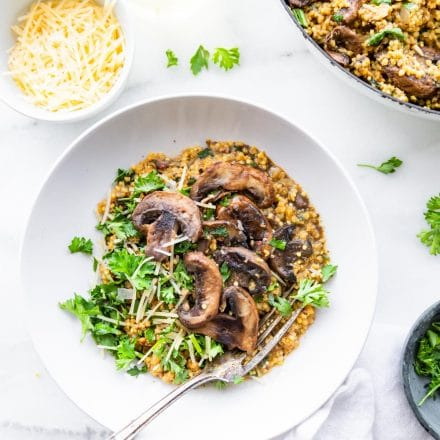 bowl of gluten free risotto with mushrooms and millet