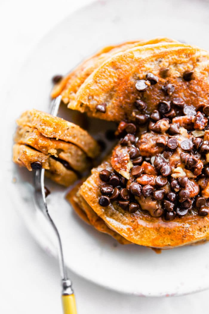 stack of fluffy paleo pancakes topped with dairy free chocolate chips