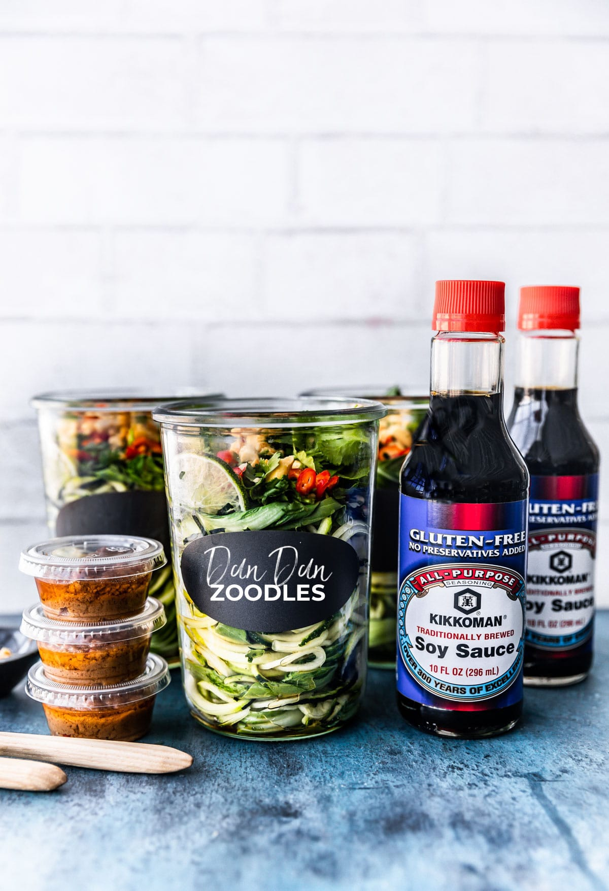 jar of zoodles with sauce on side and soy sauce bottle