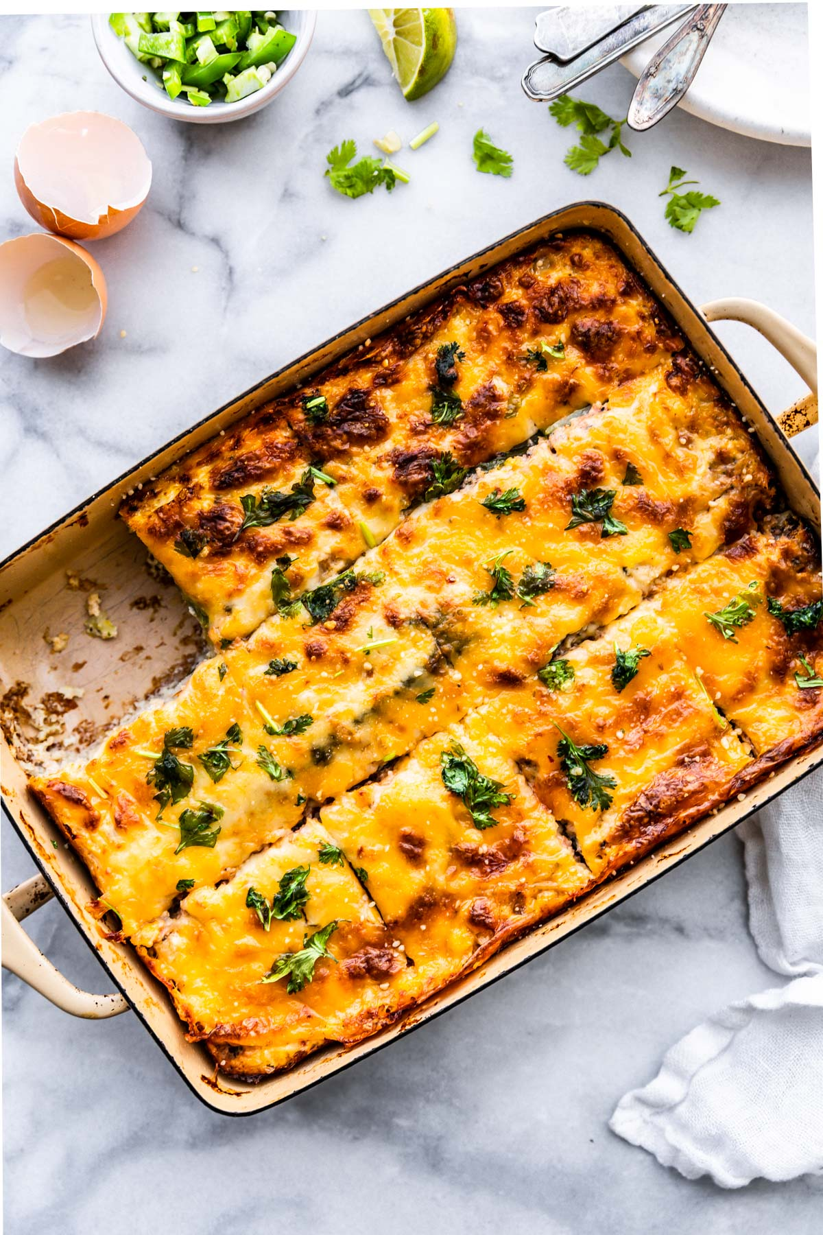 egg casserole cut and served on table