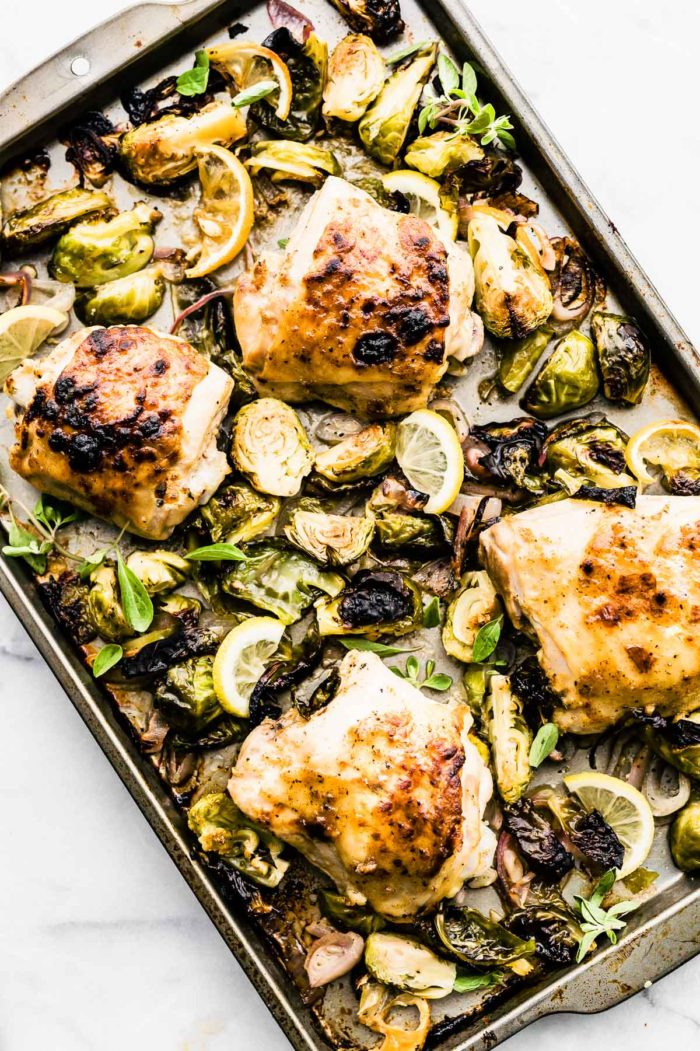 honey mustard chicken with brussels sprouts on a sheet pan