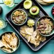 platter of avocado cranberry salsa with stone baked tortilla chips