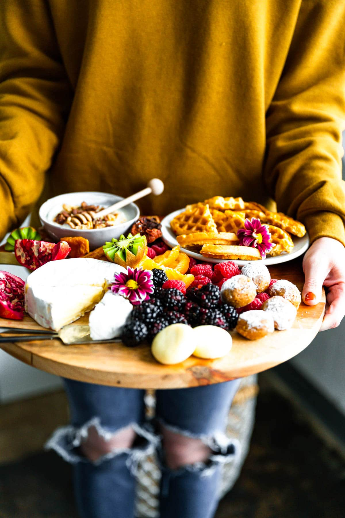 wooden tray filled with nutritious and delicious brunch finger foods