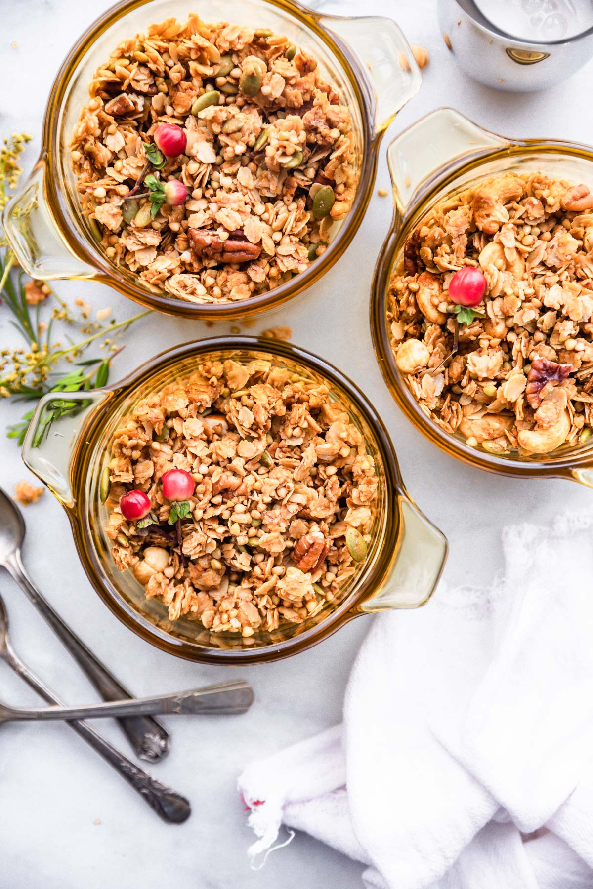 This homemade granola has buckwheat groats and is lightly sweetened with maple syrup. It's a delicious, wholesome anytime snack. Plus, it's perfect for holiday food gifts! Pair it with whatever you'd like-  yogurt, milk, dried fruit, chocolate, etc. Or, eat it by itself! This granola recipe is vegan and refined sugar free. #granola #glutenfree #vegan #homemade