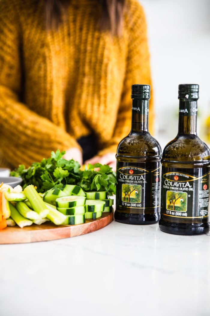 2 dark glass bottles of olive oil