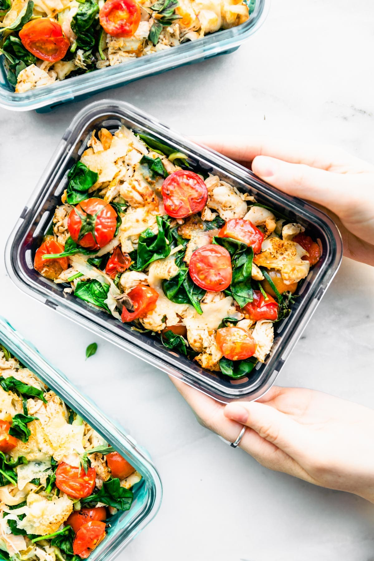 rectangular meal prep container with Italian chicken and veggies casserole