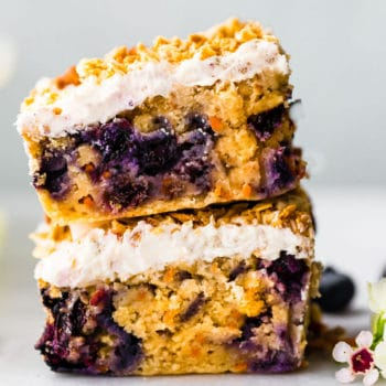 carrot cake with berries stacked on top of each other
