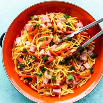 homemade Asian sweet and sour noodles in orange bowl