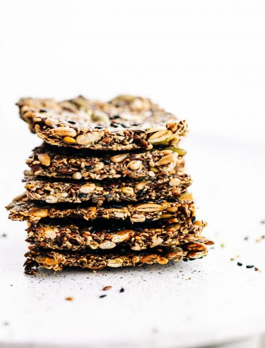 stack of homemade crackers made with 4 types of seeds