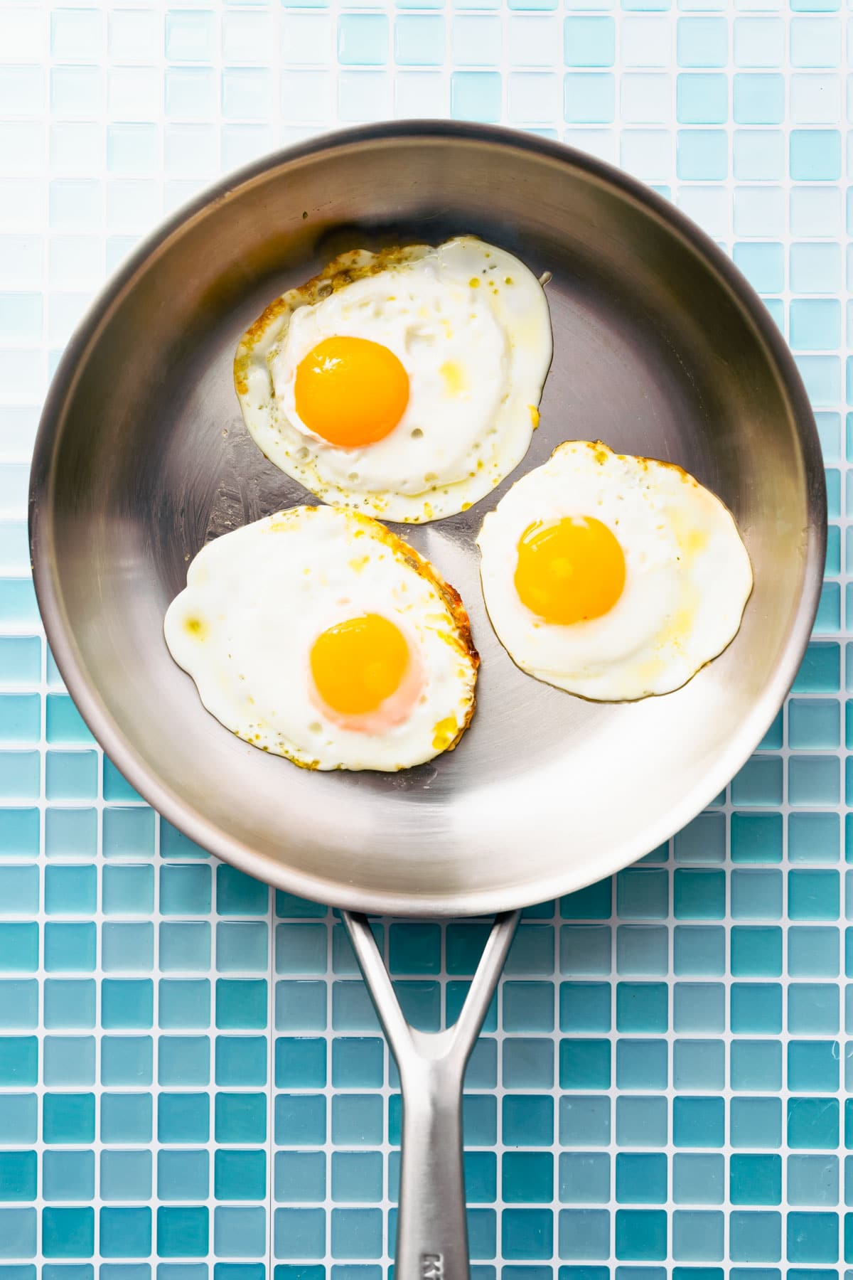 3 fried eggs in a skillet