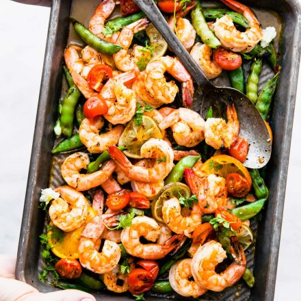 broiled shrimp and snap peas on a sheet pan