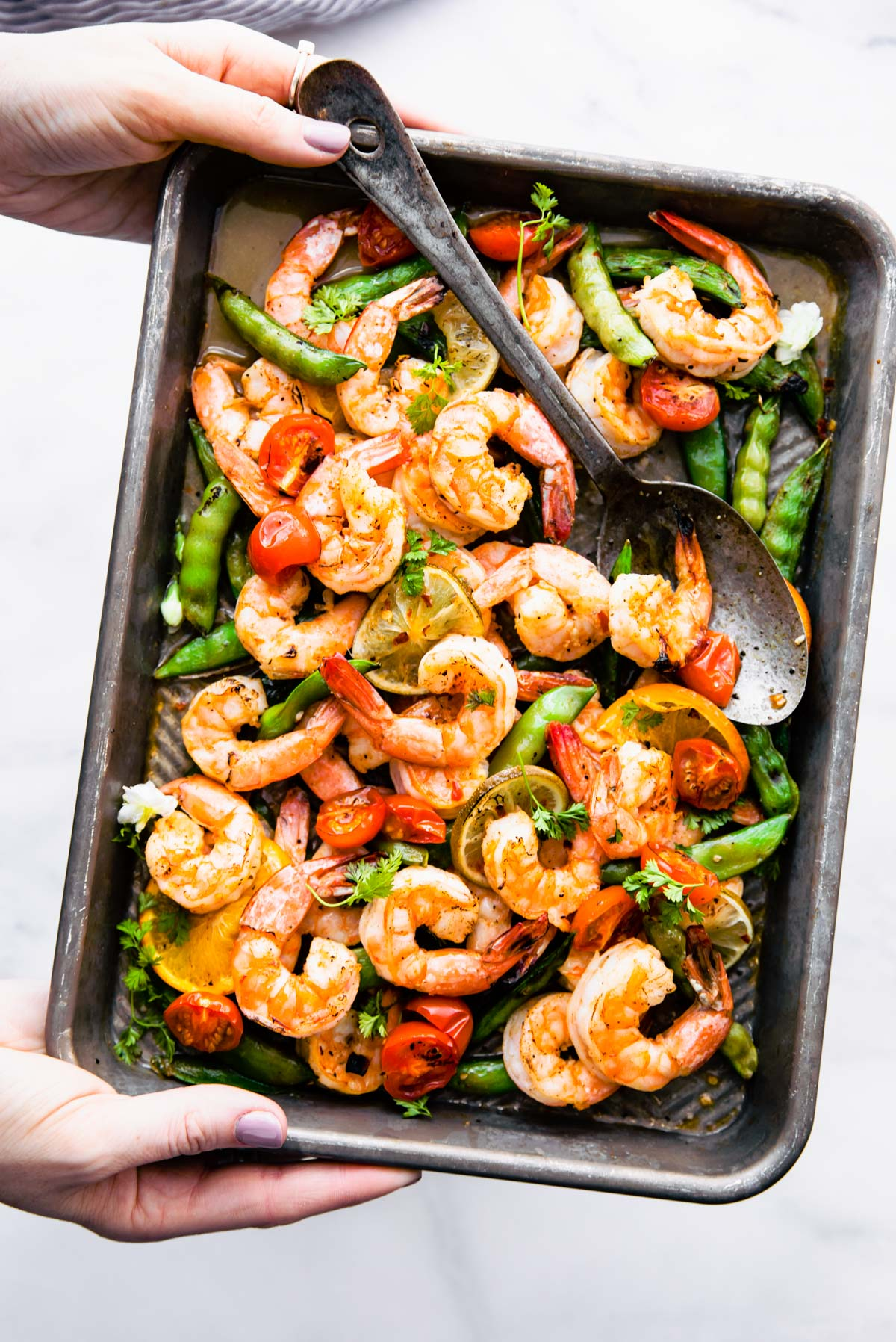 broiled shrimp on sheet pan with snap peas and lemon slices