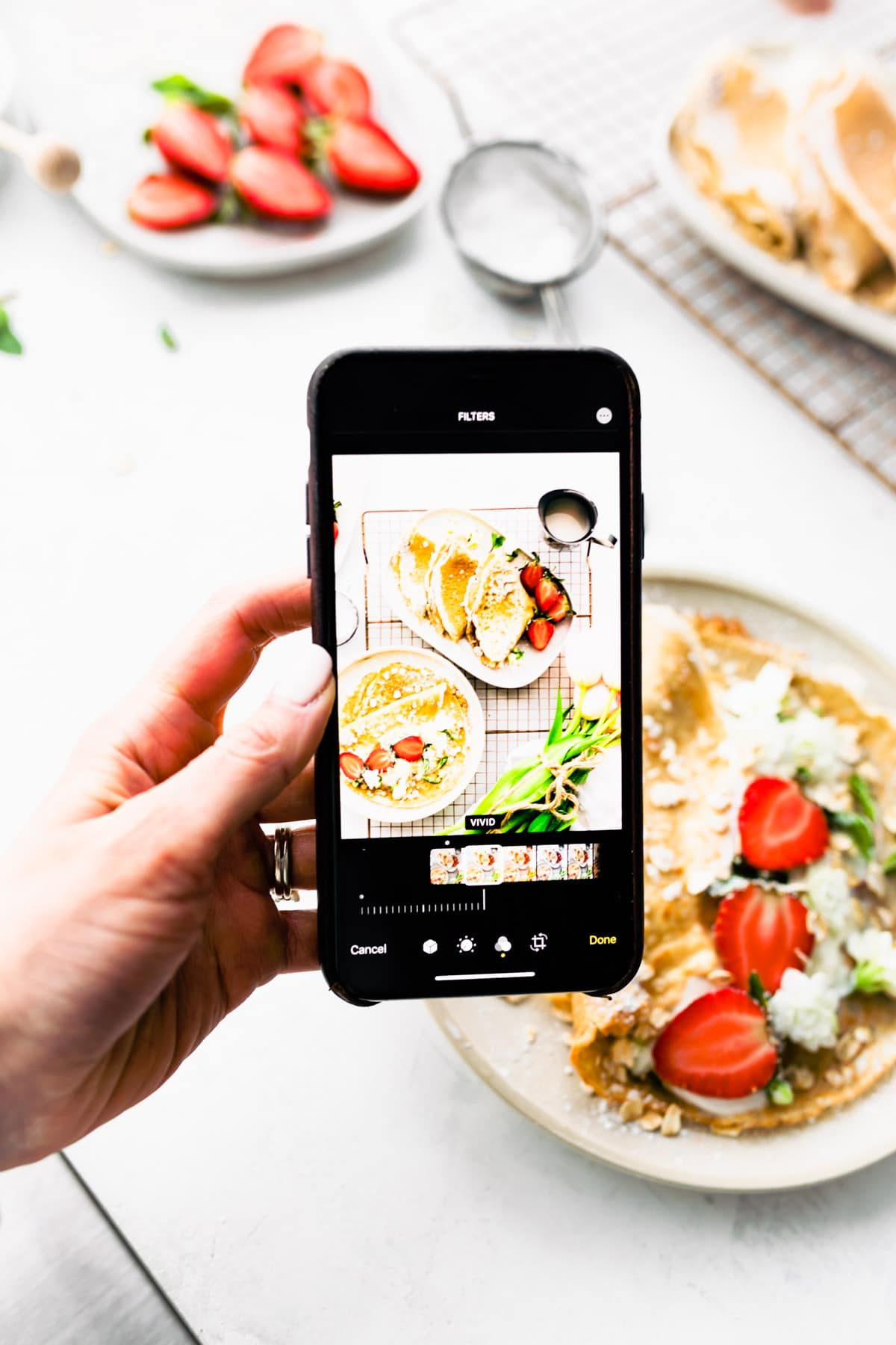 taking photo of crepes with phone
