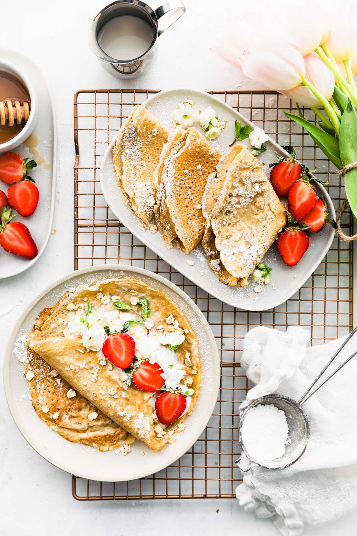 plated oatmeal crepes topped with fresh strawberries