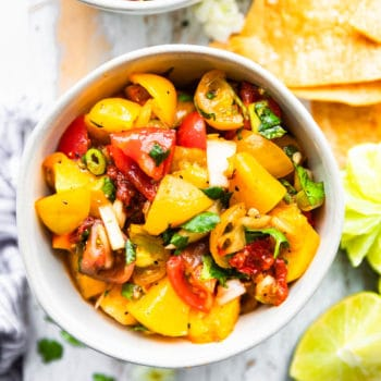 peach salsa with chipotle in cereamic bowl