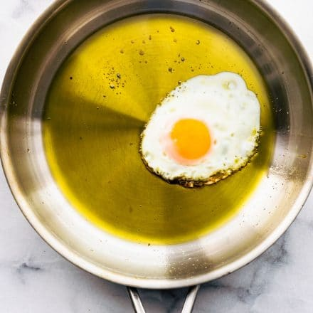 making a fried egg in olive oil