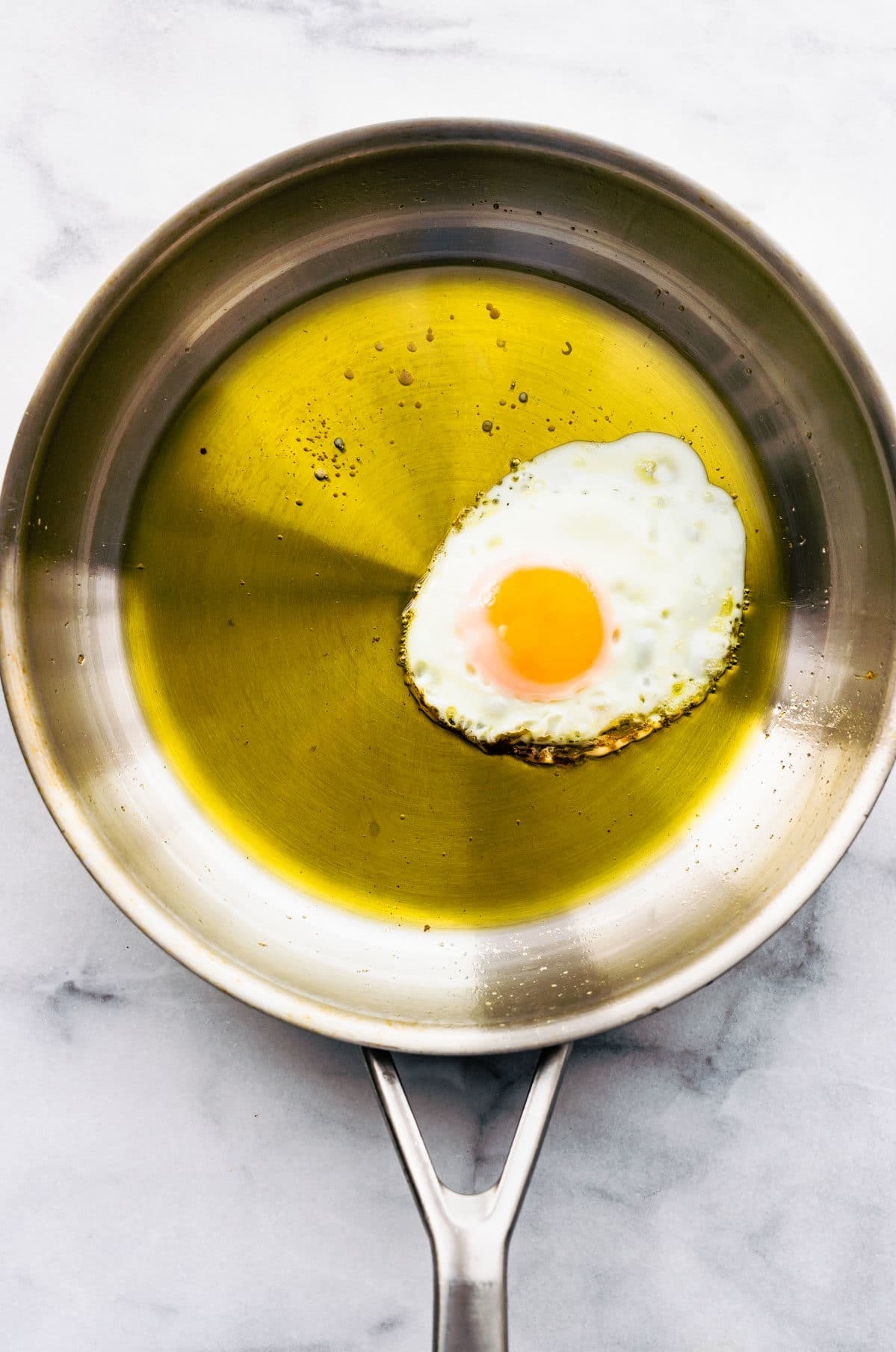 cooking eggs in olive oil in skillet