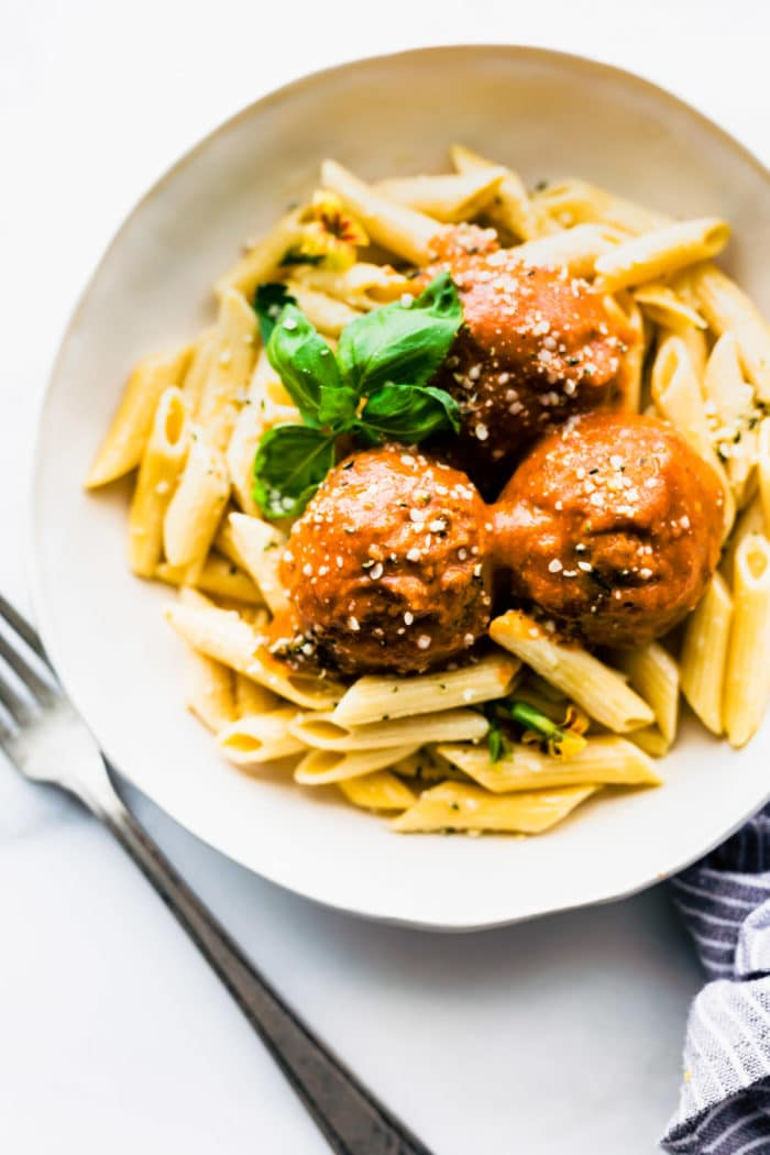 vegan meatballs on plate with ziti pasta
