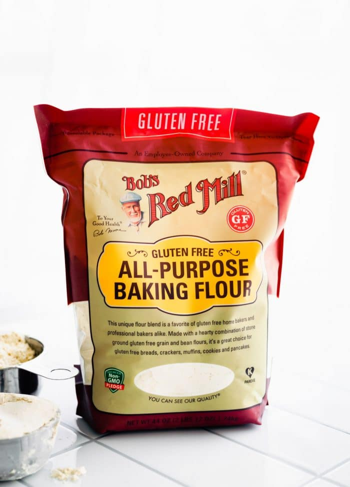 bag of bob's redmill all purpose baking flour, gluten free. sscoop of a measuring cup of flour