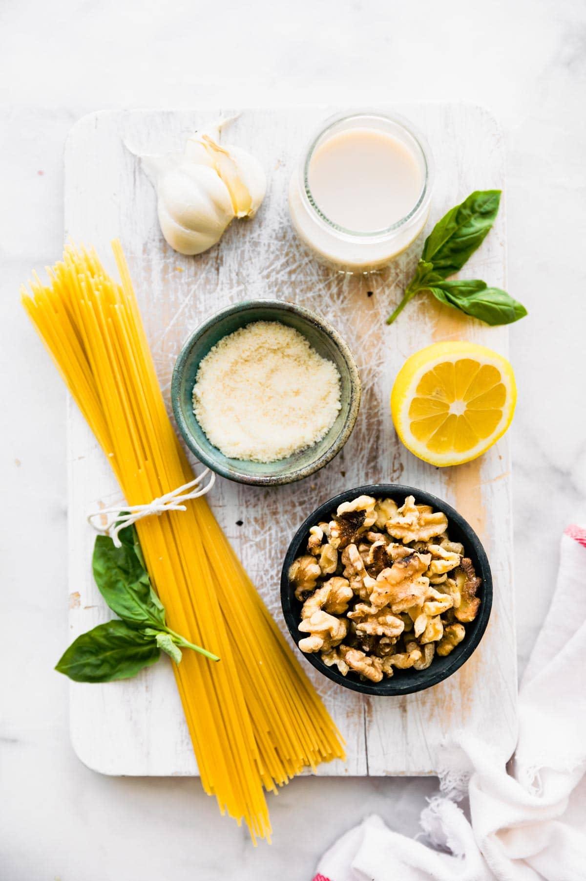 uncooked ingredients on wood cutting board to make vegan pasta recipe
