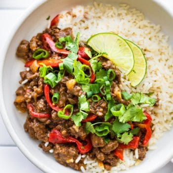 gluten free Asian beef dinner with white rice on white plate