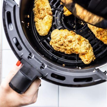 chicken tenders in an air fryer basket