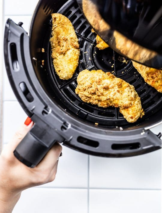 chicken tenders in an air fryer basket
