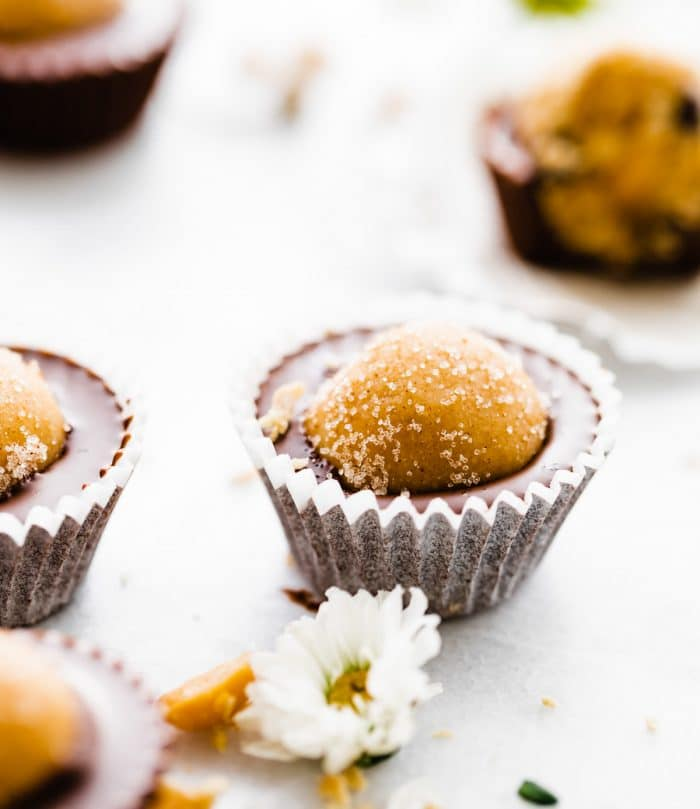 vegan edible cookie dough chocolate cups, some topped with sugar