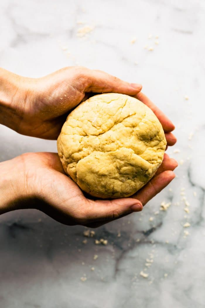 forming pizza dough into a ball