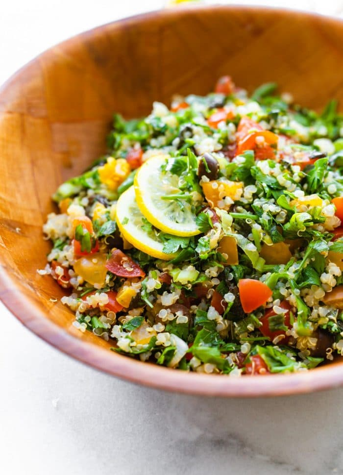 tabouli salad with quinoa in wooden salad bowl