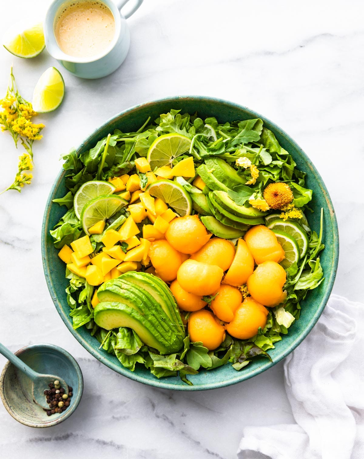 bowl of healthy fruit salad with pieces of mango avocado and cantaloupe