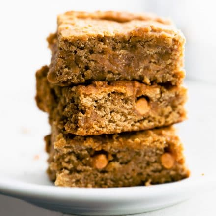 stack of 3 vegan blondies on a white plate