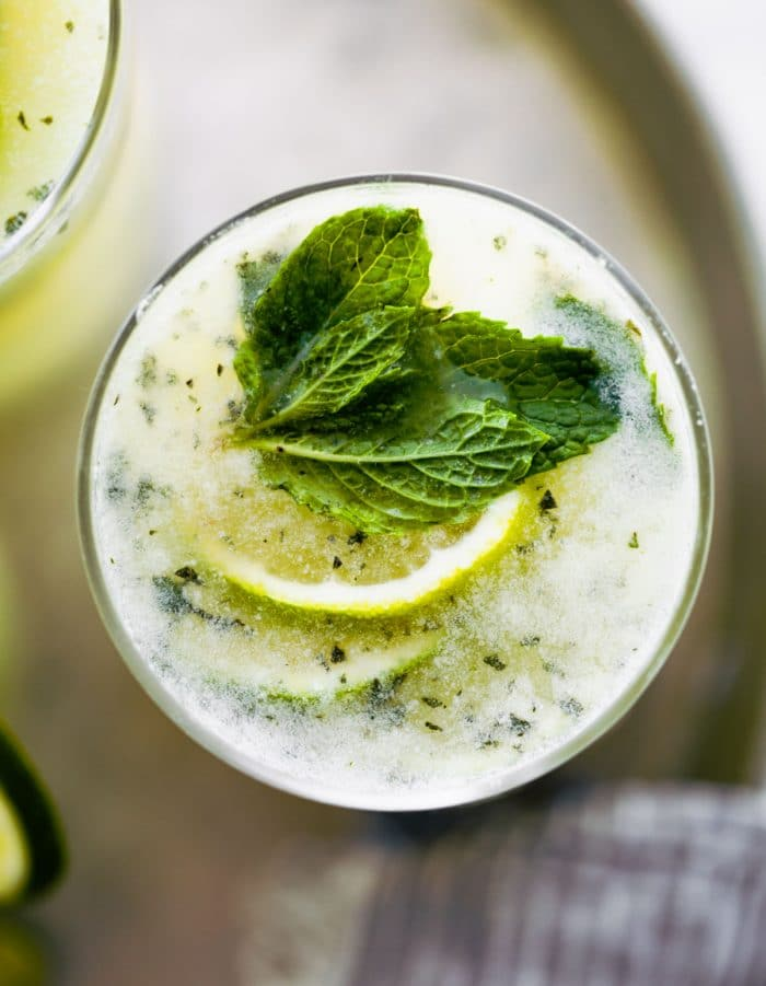 overhead photo of Brazilian limeade in glass garnished with fresh mint and lime slices