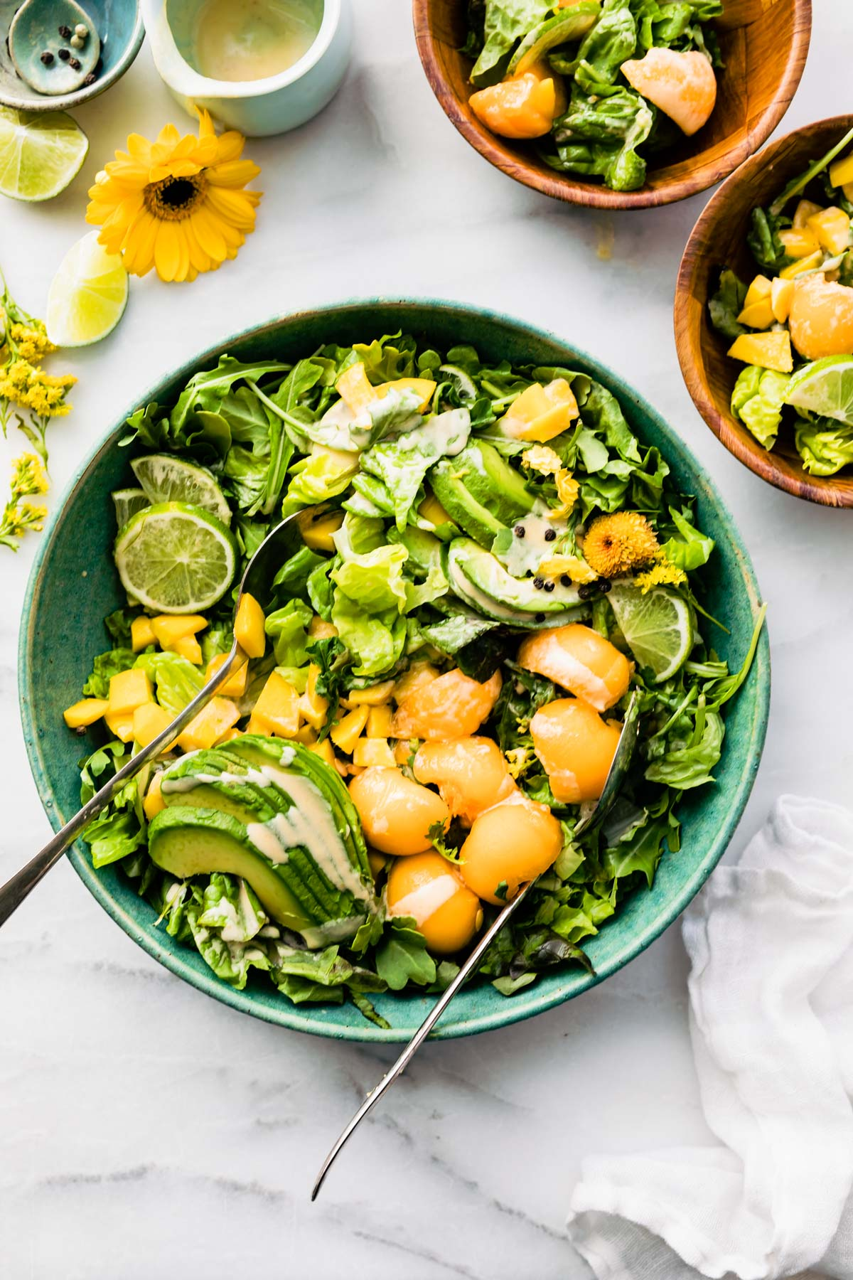 overhead image: bowl of mango avocado salad with melon dressing