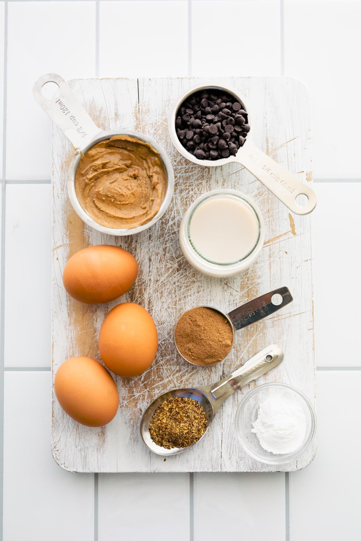 ingredients in measuring cups and bowls to make chocolate protein pancakes