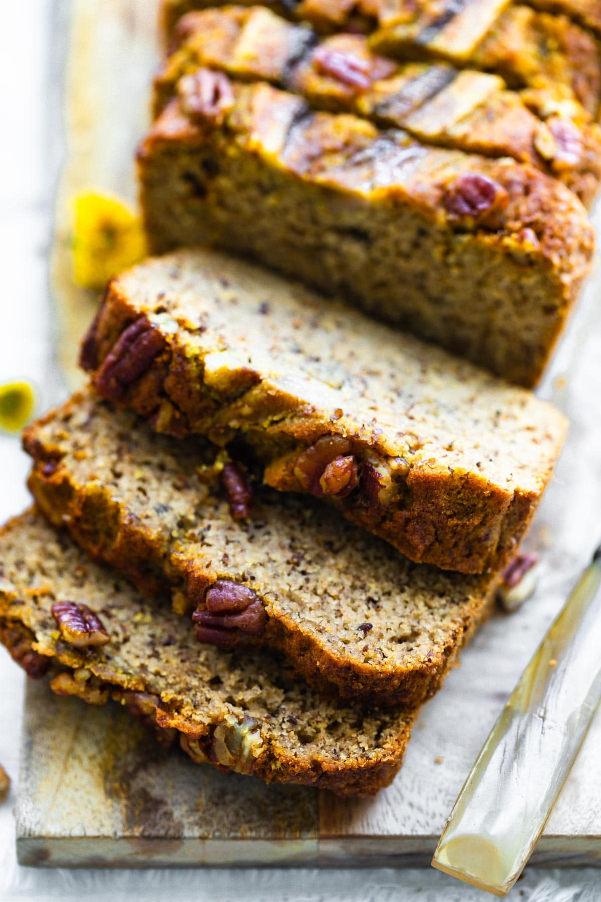 close up photo: thick slices of keto banana bread made with turmeric