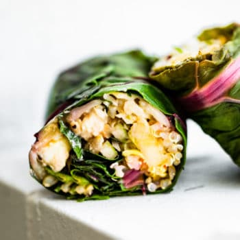 side view shows vegetarian filling inside of Swiss chard salad wraps