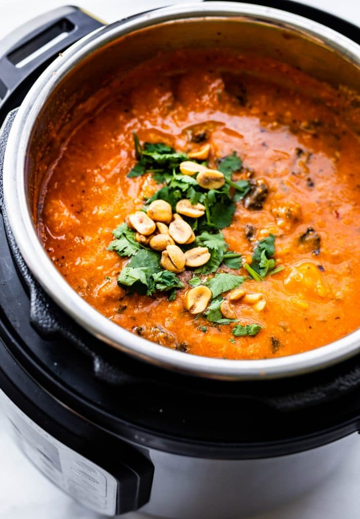 tomato-based stew with peanuts cooking in Instant Pot