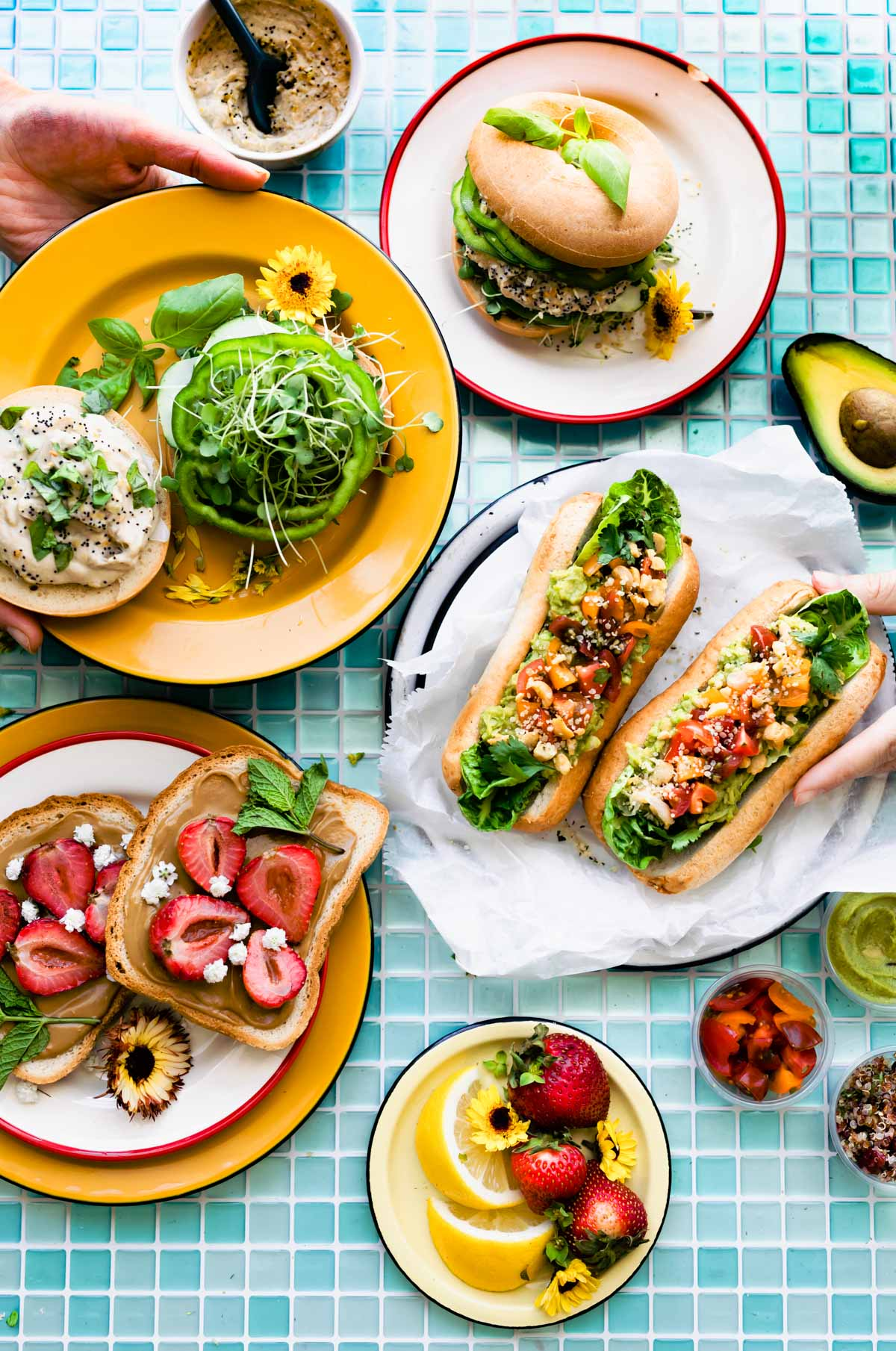 3 vegan sandwiches on colorful plates