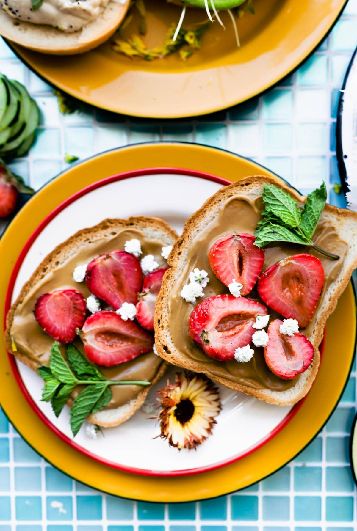 almond butter and strawberry slices on vegan toast
